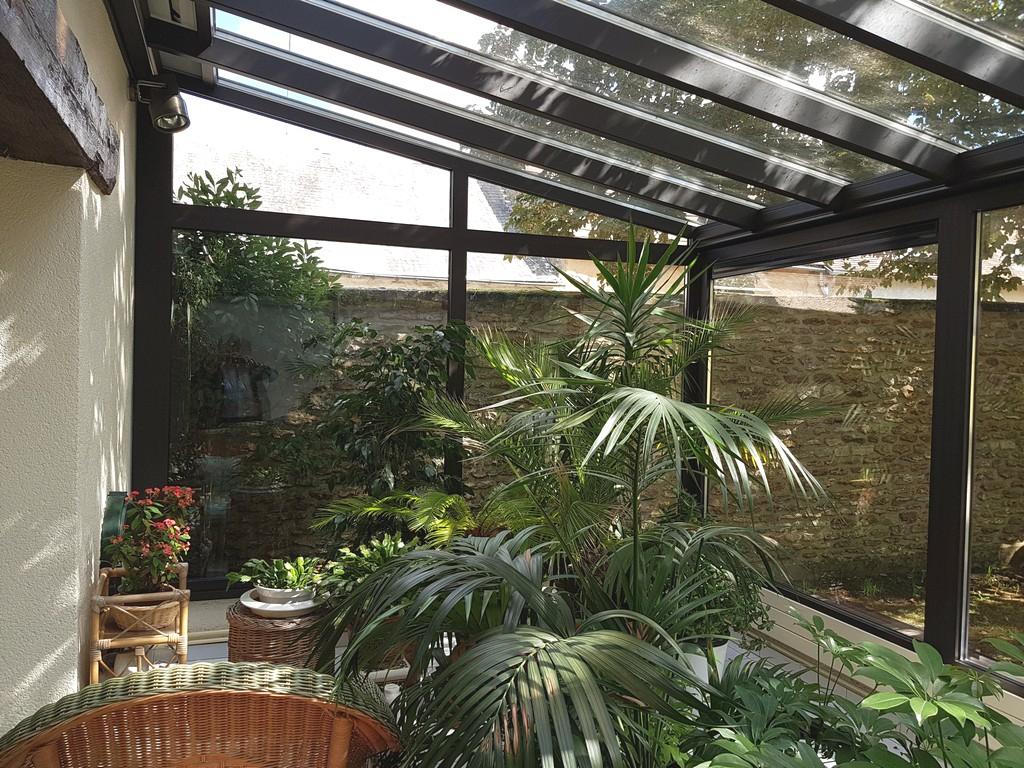 Photos Jardin D'hiver, Nouvelle Véranda Pour Une Maison ... intérieur Construire Jardin D Hiver