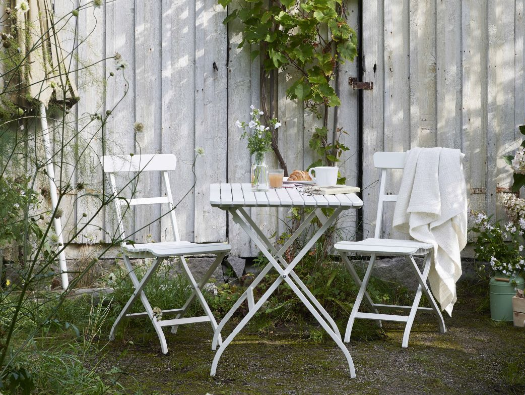 A Garden With A White Small Foldable Table And Two Chairs ... avec Ikea Table Pliante Jardin