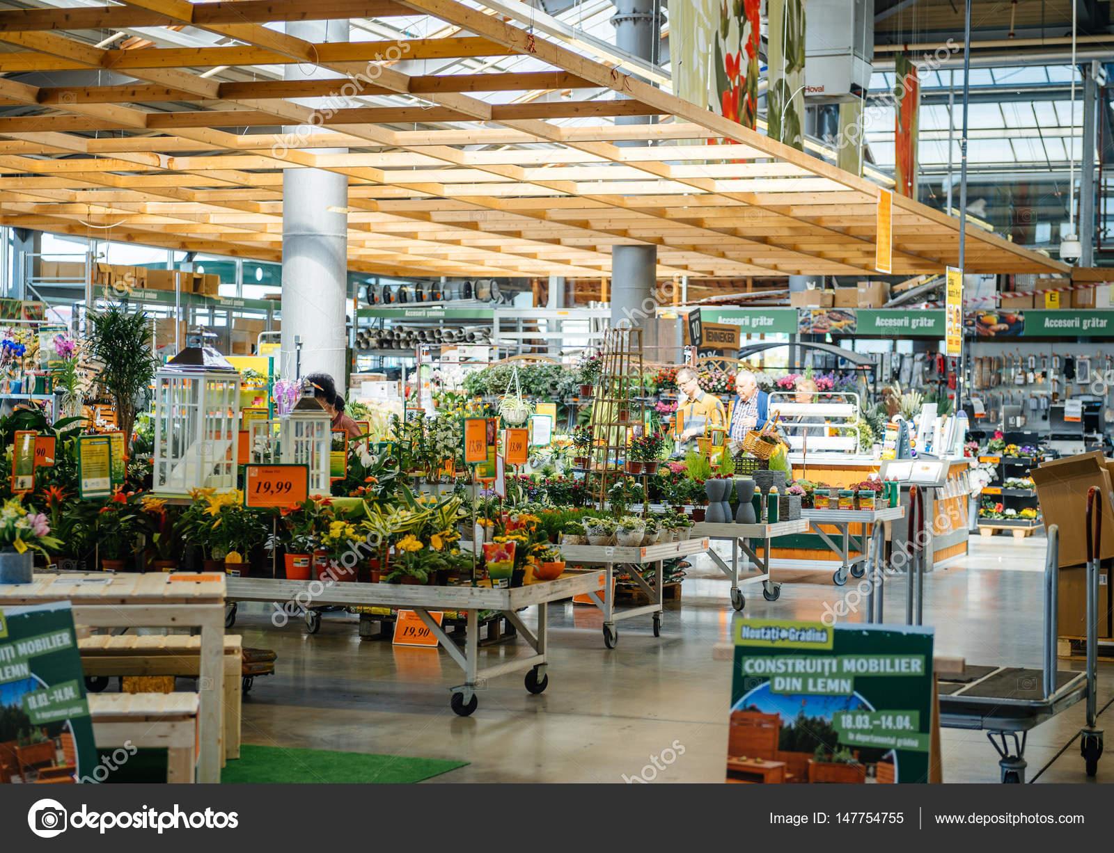 Man Buying Flowers For Garden At Hornbach Diy Store With ... concernant Hornbach Jardin