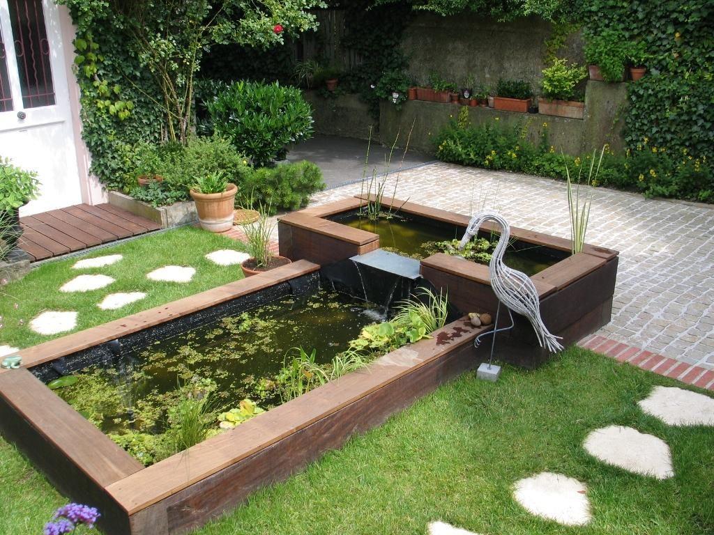 Une Cascade Sur Une Plaque En Inox Entre Deux Bacs Réalisés ... concernant Faire Un Bassin De Jardin